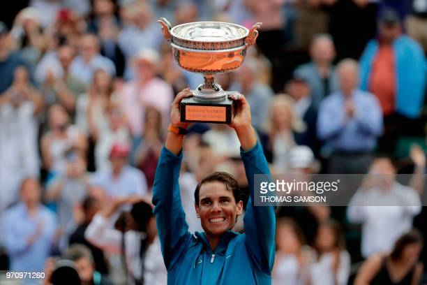Spain's Rafael Nadal holds La Coupe des Mousquetaires - The Musketeers' Trophy after defeating Austria's Dominic Thiem in their men's singles final...