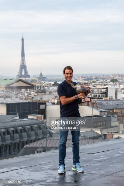 Spain's Rafael Nadal holds the Mousquetaires Cup during a photocall a day after winning the men's singles of The Roland Garros 2020 French Open...