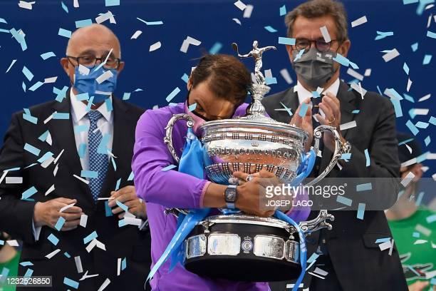 Spain's Rafael Nadal hugs the trophy after winning the ATP Barcelona Open tennis tournament singles final match against Greece's Stefanos Tsitsipas...