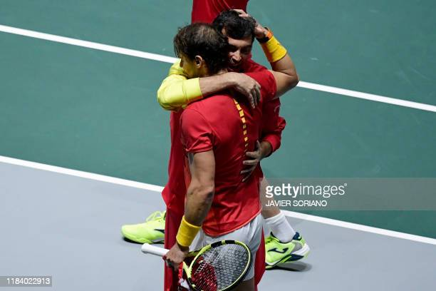 Spain's Rafael Nadal is congratulated by Spain's captain Sergi Bruguera after winning the doubles quarter-final tennis match against Argentina's...