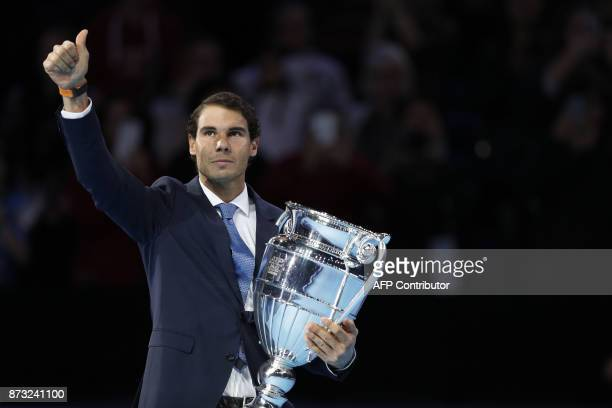 Spain's Rafael Nadal is presented with the ATP World Tour No 1 Trophy during Day One of the ATP World Tour Finals tennis tournament at the O2 Arena...