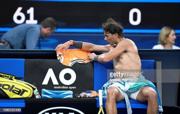 Spain's Rafael Nadal is seen during a break their Men's Singles Final match against Novak Djokovic of Serbia during day 14 of the 2019 Australian...