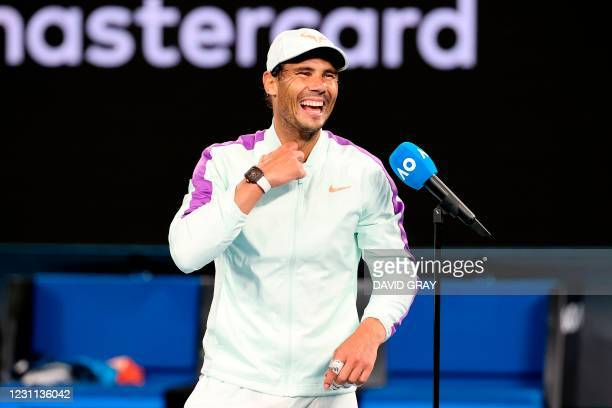 Spain's Rafael Nadal laughs during a short interview after winning against Britain's Cameron Norrie in the men's singles match on day six of the...