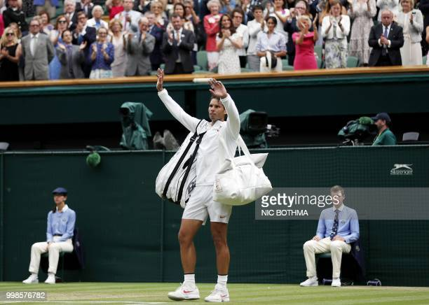 Spain's Rafael Nadal leaves court after losing to Serbia's Novak Djokovic during the continuation of their men's singles semifinal match on the...