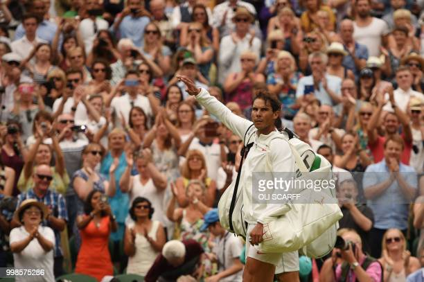 Spain's Rafael Nadal leaves the court after losing to Serbia's Novak Djokovic during the continuation of their men's singles semifinal match on the...