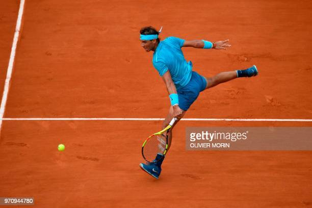 TOPSHOT Spain's Rafael Nadal plays a backhand return to Austria's Dominic Thiem during their men's singles final match on day fifteen of The Roland...