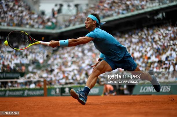 Spain's Rafael Nadal plays a forehand return to Austria's Dominic Thiem during their men's singles final match on day fifteen of The Roland Garros...