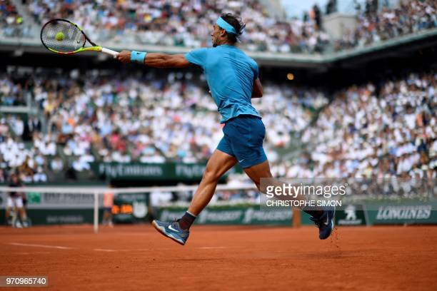 TOPSHOT Spain's Rafael Nadal plays a forehand return to Austria's Dominic Thiem during their men's singles final match on day fifteen of The Roland...