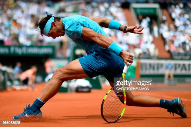 TOPSHOT Spain's Rafael Nadal plays a forehand return to France's Richard Gasquet during their men's singles third round match on day seven of The...