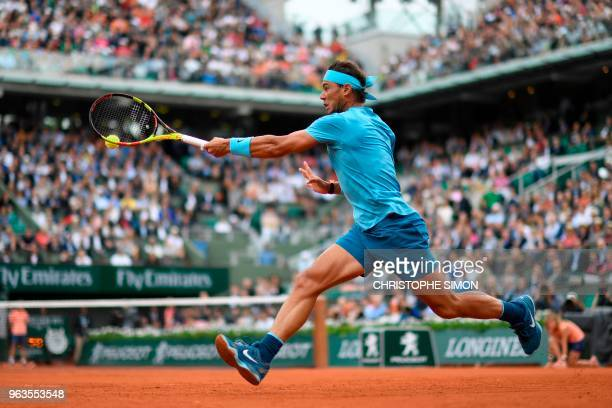 Spain's Rafael Nadal plays a forehand return to Italy's Simone Bolelli during their men's singles first round match on day three of The Roland Garros...