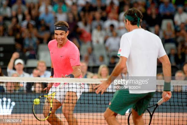 Spain's Rafael Nadal plays a return to Switzerland's Roger Federer during their tennis match at The Match in Africa at the Cape Town Stadium in Cape...
