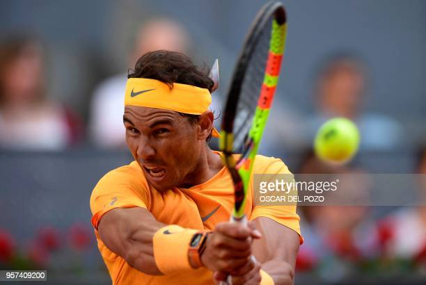 TOPSHOT Spain's Rafael Nadal plays against Austria's Dominic Thiem during their ATP Madrid Open quarterfinal tennis match at the Caja Magica in...