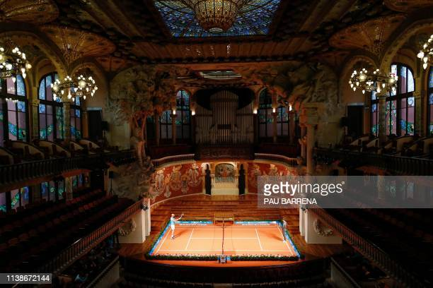 Spain's Rafael Nadal plays against Japan's Kei Nishikori during a promotional tennis match at the Palau de la Musica in Barcelona on April 22, 2019...