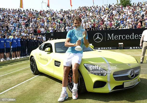 Spain's Rafael Nadal poses on the winner's car a Mercedes AMG GT S with the trophy after defeating Serbia's Viktor Troicki in the final match at the...