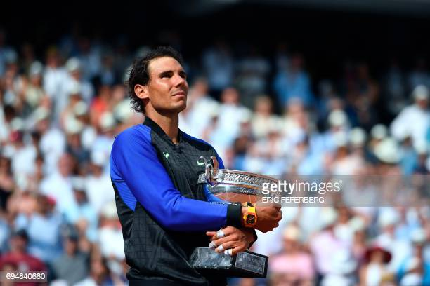 TOPSHOT Spain's Rafael Nadal poses with his trophy after winning the men's final tennis match against Switzerland's Stanislas Wawrinka at the Roland...