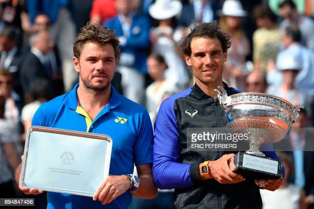 Spain's Rafael Nadal poses with his trophy next to second placed Switzerland's Stanislas Wawrinka after the men's final tennis match at the Roland...