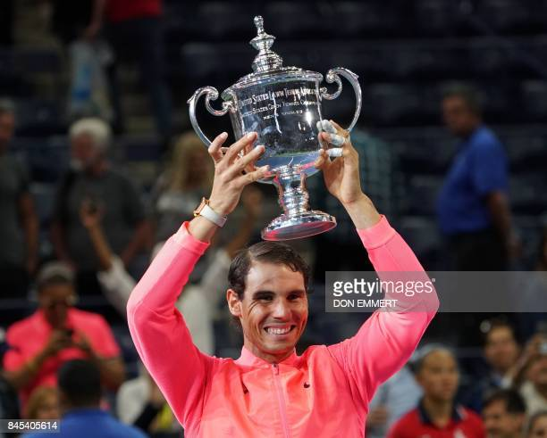 Spain's Rafael Nadal poses with his winning trophy after defeating South Africa's Kevin Anderson during their 2017 US Open Men's Singles final match...