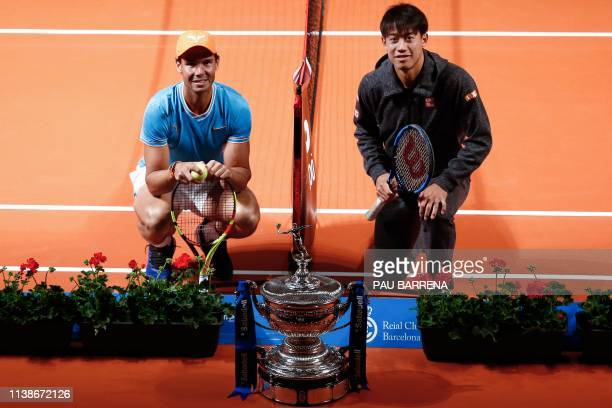 Spain's Rafael Nadal poses with Japan's Kei Nishikori at the Palau de la Musica in Barcelona on April 22, 2019 on the sidelines of the Barcelona ATP...