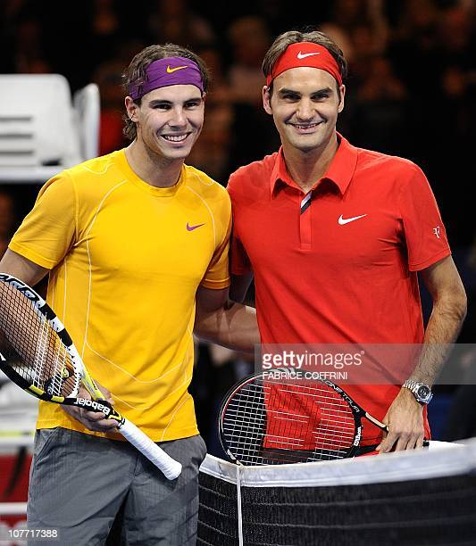 Spain's Rafael Nadal poses with Switzerland's Roger Federer prior to their charity game on December 21 2010 in Zurich The Match for Africa was...
