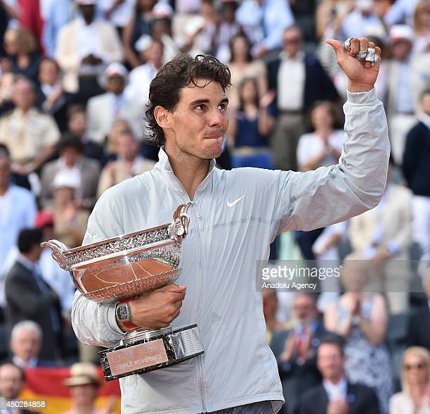 Spain's Rafael Nadal poses with the Musketeers trophy after winning the French tennis Open men's final match against his Serbian rival Novak Djokovic...