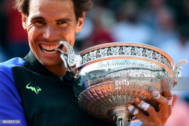 Spain's Rafael Nadal poses with the trophy after the men's final tennis match against Switzerland's Stanislas Wawrinka at the Roland Garros 2017...