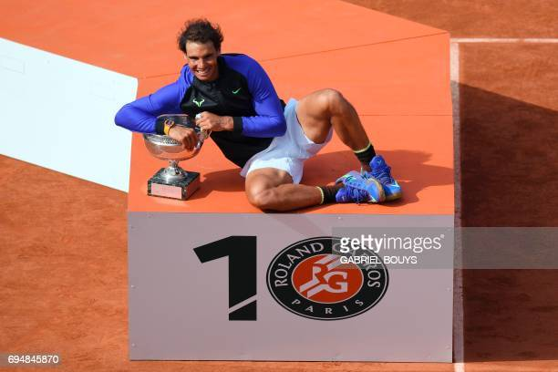 TOPSHOT Spain's Rafael Nadal poses with the trophy after winning the men's final tennis match against Switzerland's Stanislas Wawrinka at the Roland...