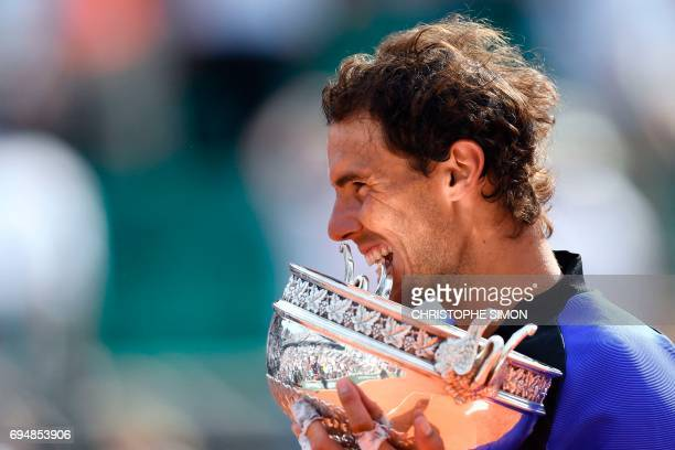 Spain's Rafael Nadal poses with the trophy after winning the men's final tennis match against Switzerland's Stanislas Wawrinka at the Roland Garros...
