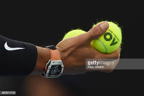 Spain's Rafael Nadal prepares to serve against Switzerland's Roger Federer during their men's singles final match on day 14 of the Australian Open...