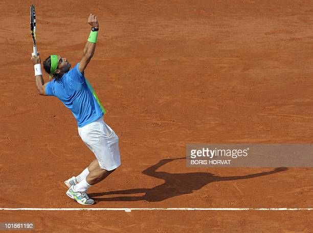 Spain's Rafael Nadal prepares to serve during his men's quarter-final against compatriot Nicolas Almagro in the French Open tennis championship at...