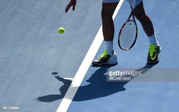 Spain's Rafael Nadal prepares to serve during his men's singles match against Russia's Mikhail Youzhny on day one of the 2015 Australian Open tennis...