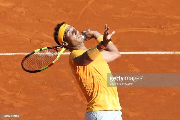Spain's Rafael Nadal prepares to smash a ball to Russia's Karen Khachanov during their round of 16 tennis match at the MonteCarlo ATP Masters Series...