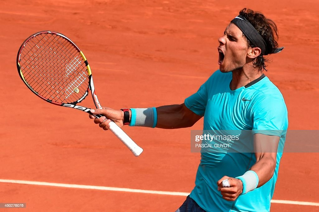 Spain's Rafael Nadal reacts after a point during his French tennis Open men's final match against Serbia's Novak Djokovic at the Roland Garros stadium in Paris on June 8, 2014. AFP PHOTO / PASCAL GUYOT / AFP PHOTO / Pascal GUYOT