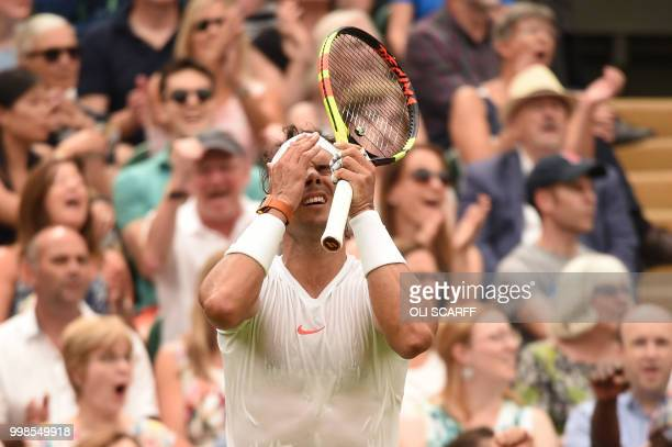 TOPSHOT Spain's Rafael Nadal reacts after losing a point in the fifth set against Serbia's Novak Djokovic during the continuation of their men's...