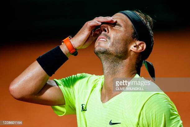 Spain's Rafael Nadal reacts after losing a point to Argentina's Diego Schwartzman during their quarter final match of the Men's Italian Open at Foro...