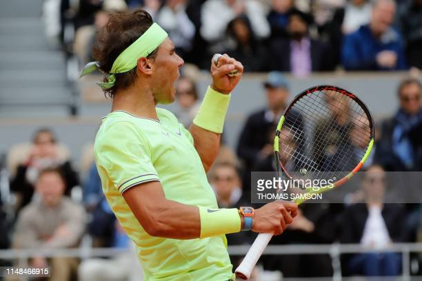 Spain's Rafael Nadal reacts after winning a point against Switzerland's Roger Federer during their men's singles semifinal match on day 13 of The...