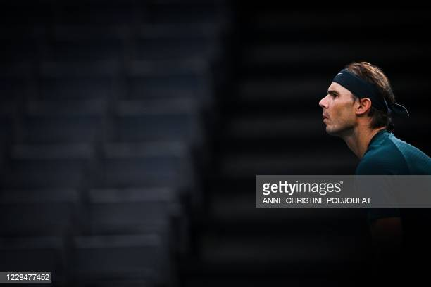Spain's Rafael Nadal reacts as he plays against Australia's Jordan Thompson during their men's singles round of sixteen tennis match on day 4 at the...