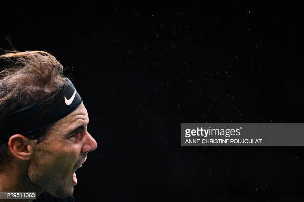 Spain's Rafael Nadal reacts as he serves the ball to Germany's Alexander Zverev during their men's singles semi-final tennis match on day 6 at the...