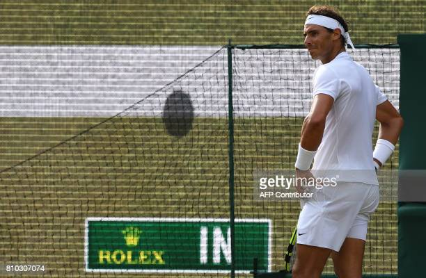 Spain's Rafael Nadal reacts as the scoreboard shows the result of a hawkeye challenge during a point against Russia's Karen Khachanov during their...