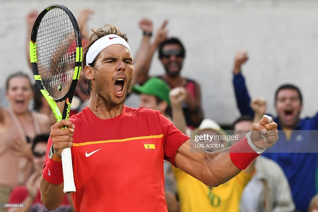 Spain's Rafael Nadal reacts during his men's singles semi-final tennis match against Argentina's Juan Martin Del Potro at the Olympic Tennis Centre of the Rio 2016 Olympic Games in Rio de Janeiro on August 13, 2016. / AFP / Luis Acosta