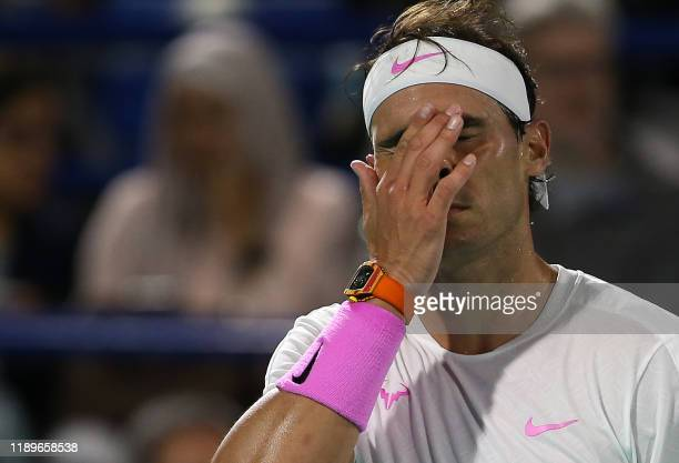 TOPSHOT Spain's Rafael Nadal reacts during his semifinal match against Russia's Karen Khachanov at Zayed Sports City in Abu Dhabi on December 20 2019