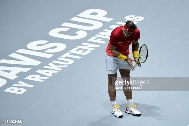 Spain's Rafael Nadal reacts during the doubles quarter-final tennis match against Argentina's Leonardo Mayer and Argentina's Maximo Gonzalez at the...