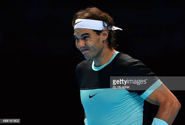 Spain's Rafael Nadal reacts during the men's singles semifinal match against Serbia's Novak Djokovic on day seven of the ATP World Tour Finals tennis...