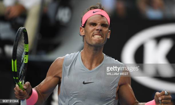 TOPSHOT Spain's Rafael Nadal reacts during their men's singles fourth round match against Argentina's Diego Schwartzman on day seven of the...