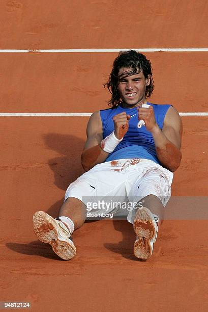 Spain's Rafael Nadal reacts to his win over Switzerland's Roger Federer at the men's final of the French Open tennis tournament at Roland Garros...