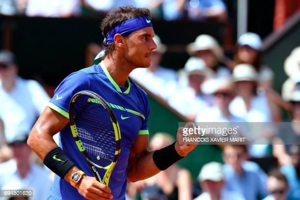 Spain's Rafael Nadal reacts winning a point against Switzerland's Stanislas Wawrinka during the men's final tennis match at the Roland Garros 2017...