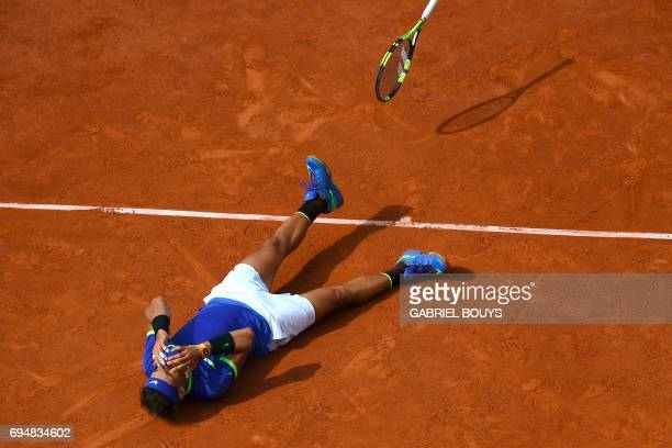 Spain's Rafael Nadal reacts winning against Switzerland's Stanislas Wawrinka during the men's final tennis match at the Roland Garros 2017 French...