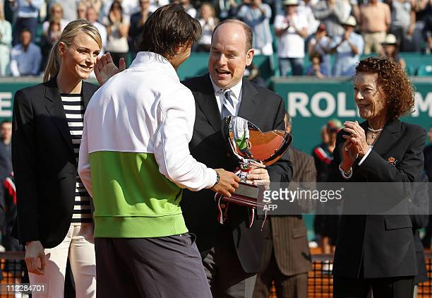 Spain's Rafael Nadal receives the trophy from Prince Albert II of Monaco his fiancee South African Charlene Wittstock and Princess ElisabethAnne De...