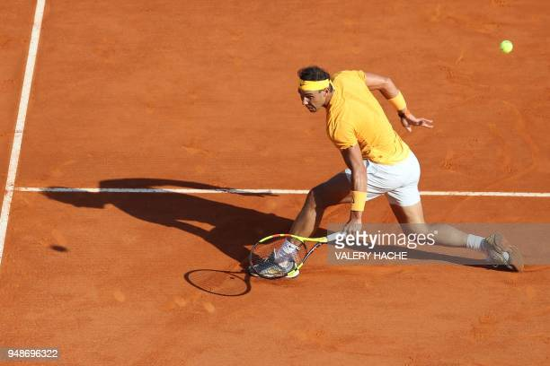 Spain's Rafael Nadal returns a ball to Russia's Karen Khachanov during their round of 16 tennis match at the MonteCarlo ATP Masters Series Tournament...