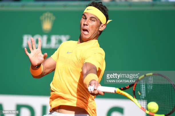 Spain's Rafael Nadal returns a ball to Russia's Karen Khachanov during their tennis match at the Monte-Carlo ATP Masters Series tournament on April...