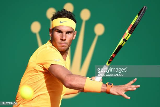 TOPSHOT Spain's Rafael Nadal returns a ball to Russia's Karen Khachanov during their tennis match at the MonteCarlo ATP Masters Series tournament on...